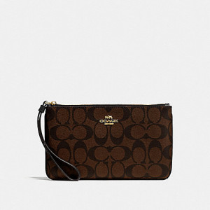 COACH LARGE WRISTLET IN SIGNATURE CANVAS (IM/BROWN/BLACK)