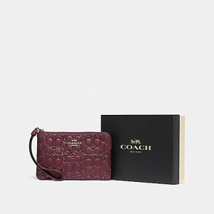 COACH BOXED CORNER ZIP WRISTLET IN SIGNATURE LEATHER (SV/WINE)